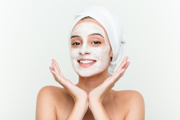 Young caucasian woman enjoying offacial mask treatment
