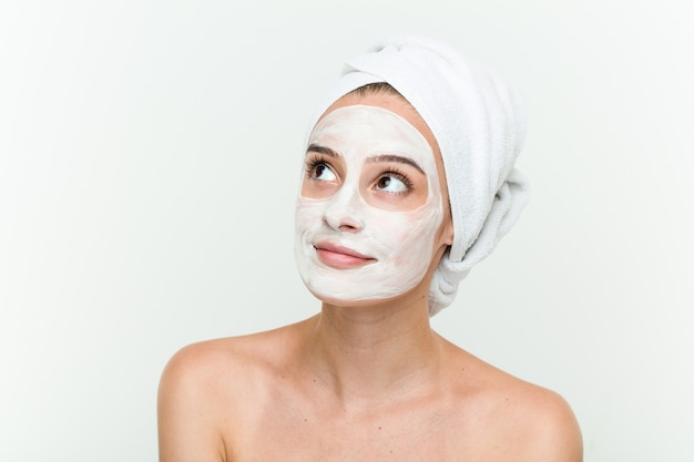 Young caucasian woman enjoying offacial mask treatment
