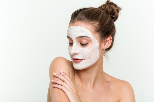 Young caucasian woman enjoying of a skin treatment