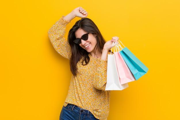 Young caucasian woman going to shopping