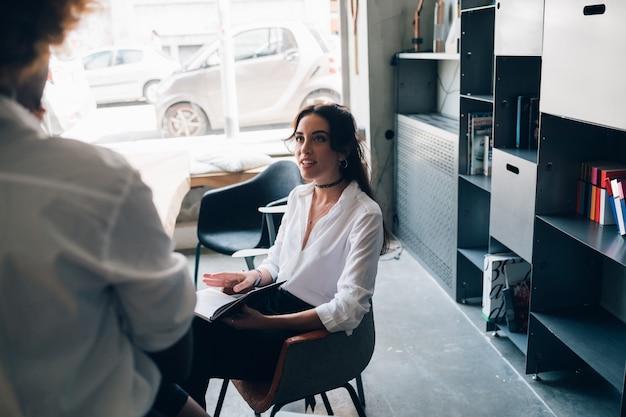 Young caucasian woman having conversation in modern studio