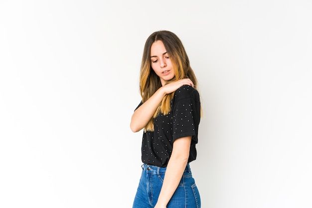 Young caucasian woman having a shoulder pain.
