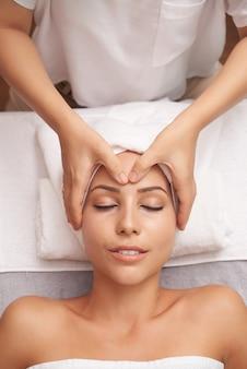 Young caucasian woman having spa procedures