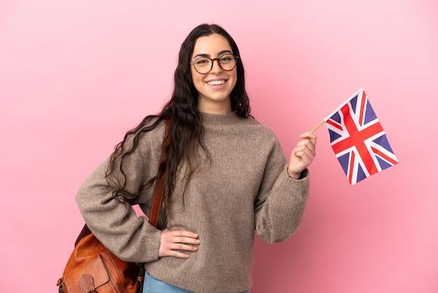 고립 된 영국 국기를 들고 젊은 백인 여자