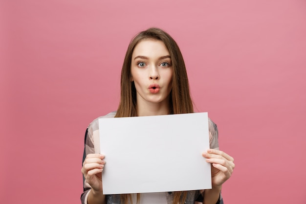 Young caucasian woman holding blank paper sheet