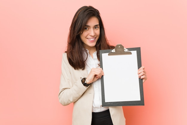 Young caucasian woman holding a clipboard