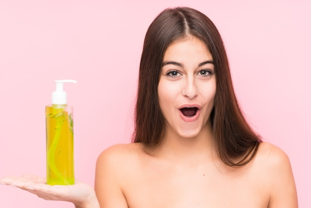 Young caucasian woman holding a moisturizer with aloe vera
