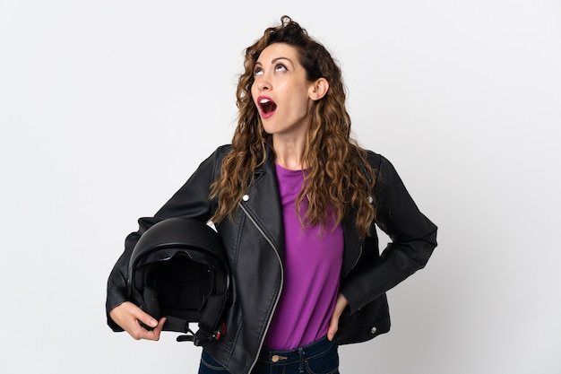Young caucasian woman holding a motorcycle helmet