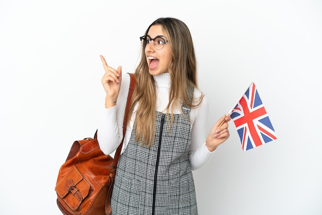 Young caucasian woman holding an united kingdom flag isolated on white background intending to realizes the solution while lifting a finger up