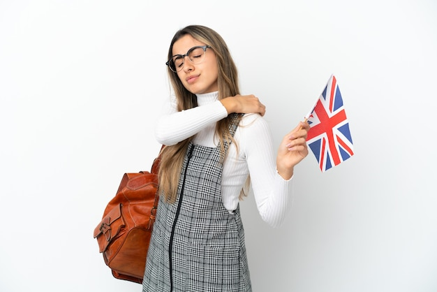 Young caucasian woman holding an united kingdom flag isolated on white background suffering from pain in shoulder for having made an effort