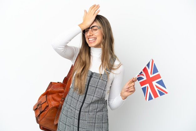 Young caucasian woman holding an united kingdom flag isolated on white wall has realized something and intending the solution