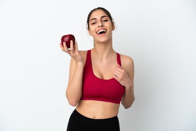 リンゴと幸せな白い背景で隔離の若い白人女性