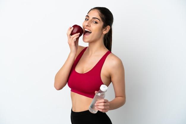 リンゴと水のボトルで白い背景で隔離の若い白人女性
