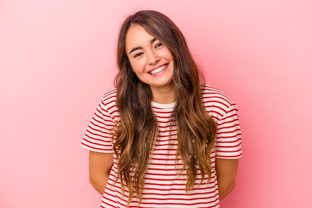 Young caucasian woman isolated on pink background happy, smiling and cheerful.