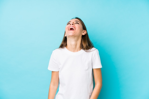Young caucasian woman  isolated relaxed and happy laughing, neck stretched showing teeth.