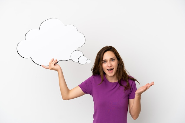 Young caucasian woman isolated on white background holding a thinking speech bubble and with sad expression