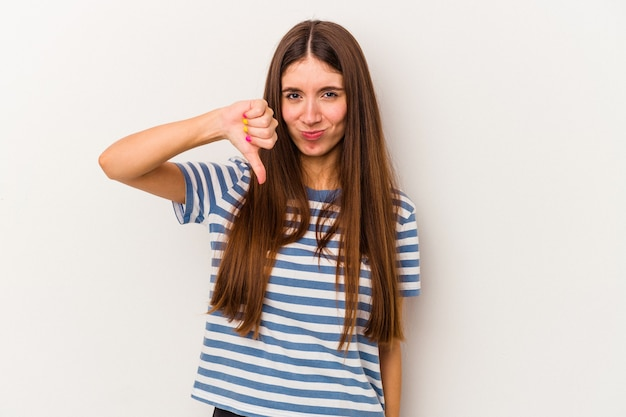 Young caucasian woman isolated on white background showing thumb down and expressing dislike.