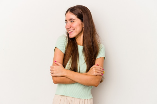 Young caucasian woman isolated on white background smiling confident with crossed arms.