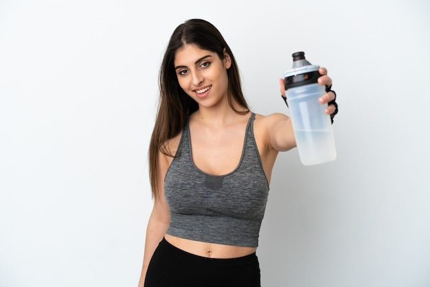 Young caucasian woman isolated on white background with sports water bottle