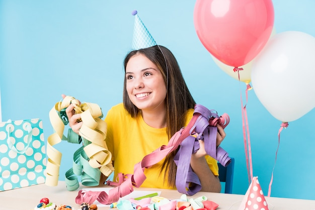 Young caucasian woman preparing a birthday party