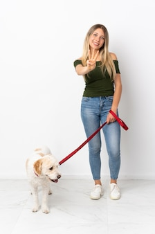 Young caucasian woman walking the dog