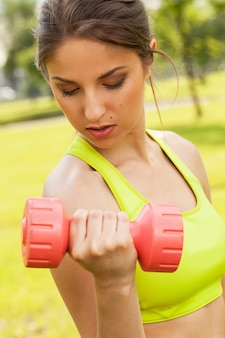 Young caucasian woman with dumbbells