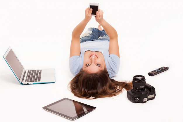 Young caucasian woman with electronic devices