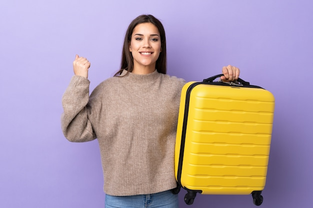 Young caucasian woman with travel suitcase
