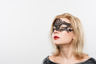 Young charming blond lady in mask
