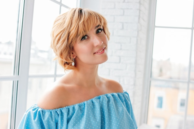 Young charming smiling blonde short hair woman