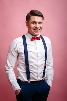 Young cheerful stylishly dressed man smiling