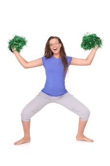 A young cheerleader posing over white