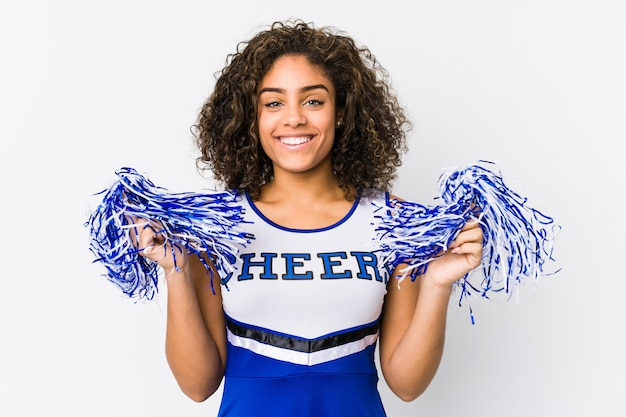 Young cheerleader woman posing