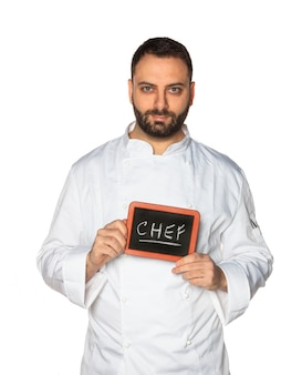Young chef with chalkboard.
