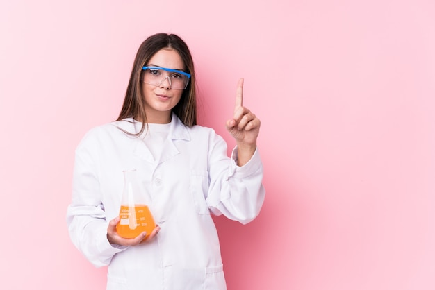 Young chemical woman isolated showing number one with finger.