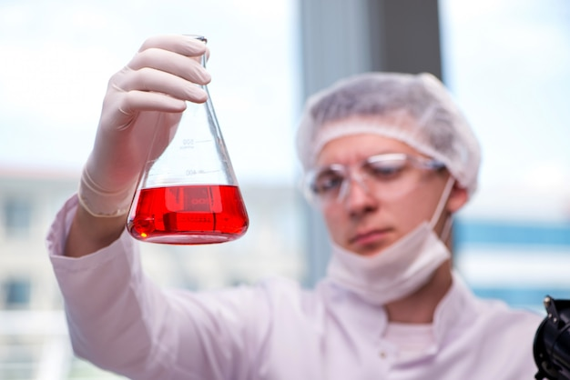 Young chemist working in the lab