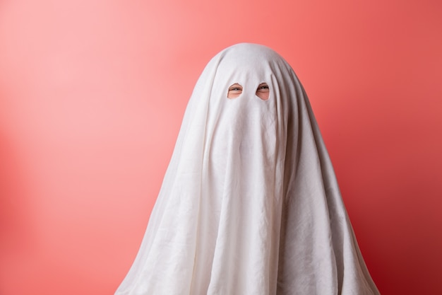 Young child dressed in a ghost costume for halloween