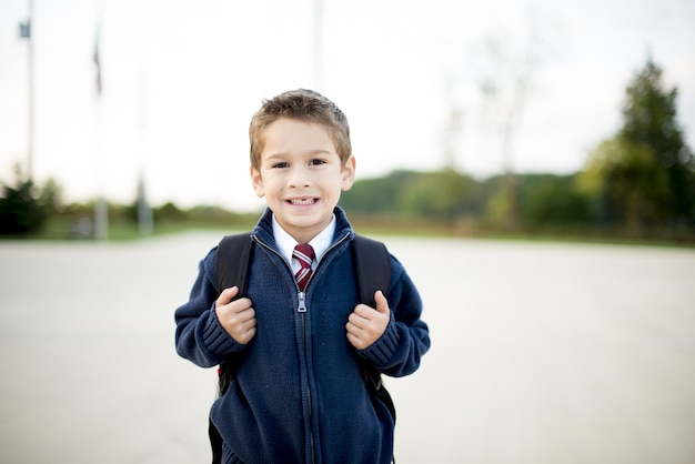Young child with a backpack behind