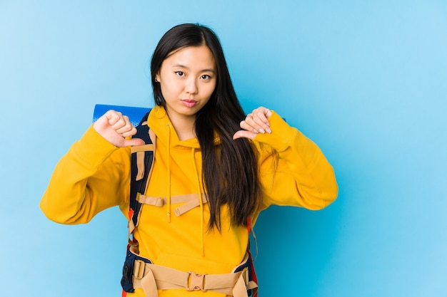 Young chinese backpacker woman isolated feels proud and self confident, example to follow.