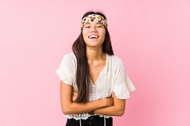 Young chinese hippie isolated laughing and having fun.