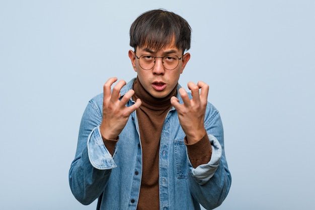 Young chinese man angry and upset