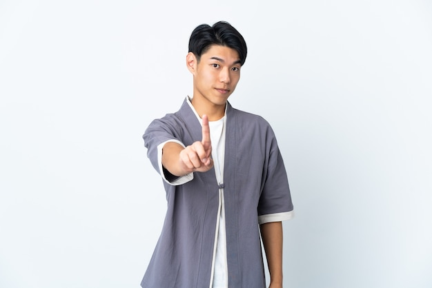 Young chinese man over isolated showing and lifting a finger