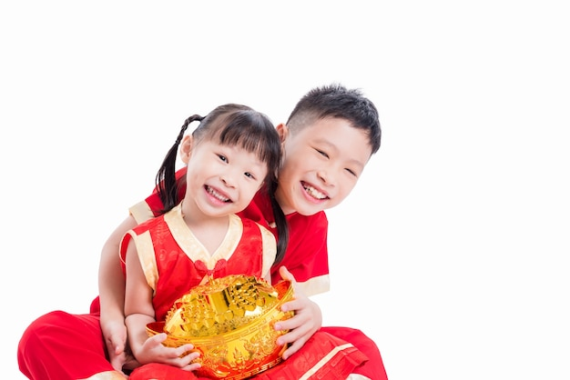 Young chinese siblings holding money bank and smiling over white background