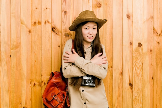 Young chinese traveler woman going cold due to low temperature or a sickness.