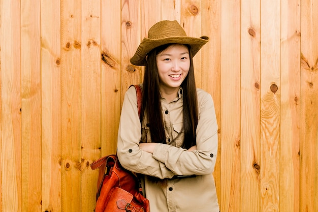 Young chinese traveler woman laughing and having fun