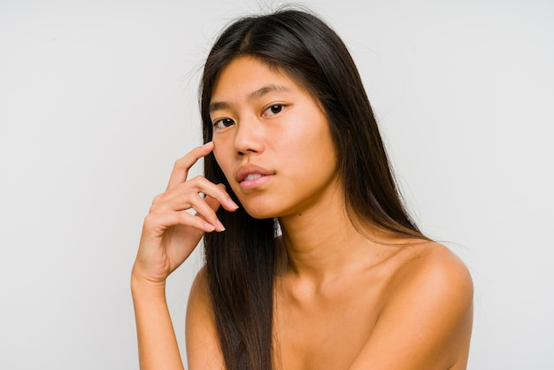Young chinese woman face close up isolated