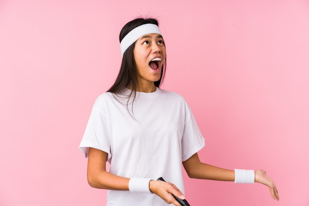 Young chinese woman playing badminton