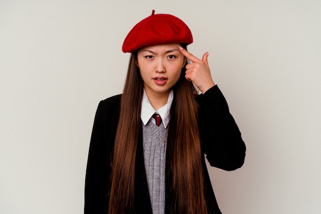 Young chinese woman wearing a school uniform isolated on white showing a disappointment gesture with forefinger.