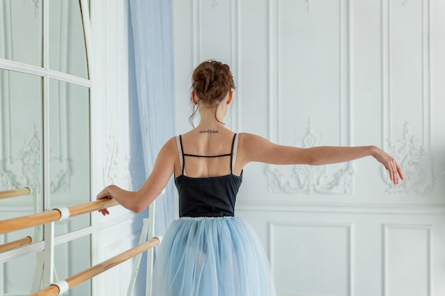 Young classical ballet dancer woman in dance class