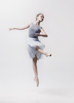 Young classical dancer isolated on white space.